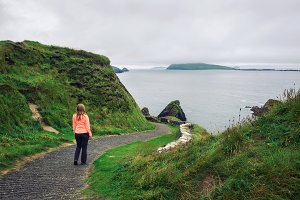 Young woman walks along pathway