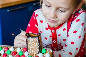 Little girl making Christmas gingerb