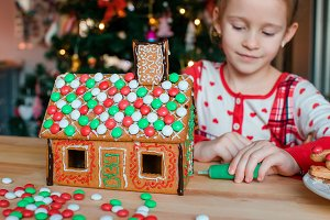 Little girls making Christmas ginger