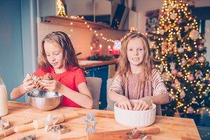 Adorable happy little girls baking C