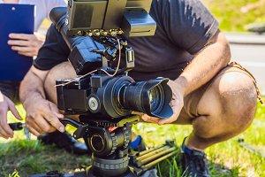 a professional cameraman prepares a