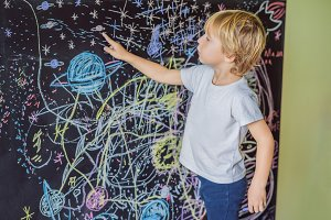 Little boy pointing space, planets