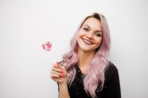 Lovely charming girl with a Lollipop