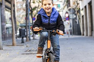 Little kid riding his bicycle