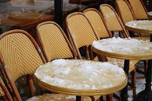 Paris. Snow. Cafe tables.