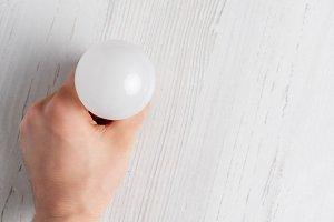 lightbulb lying on white background