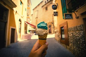 Ice Cream cone in hand in the street