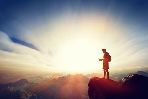 Man with smartphone on the mountain