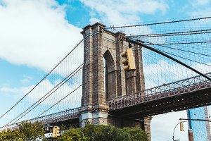 brooklyn bridge and cloudy sky in ne