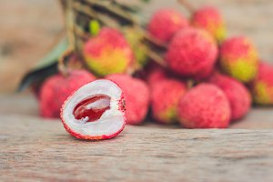 Fresh litchi fruit on an old wooden