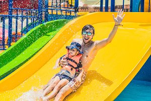 Father and son on a water slide in