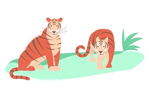 Two tigers isolated on a green