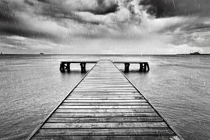 Old wooden jetty, pier on the sea