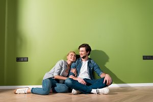loving couple sitting on floor and l