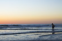 Silhoutte of surfer at sunset