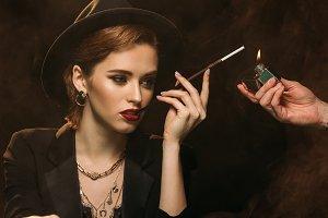 man lighting cigarette to attractive