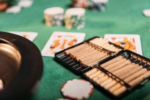roulette and cigars and poker cards
