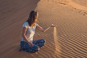 young woman in rad sandy desert at