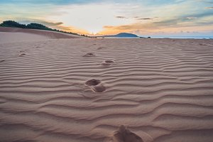 Footprints in the sand in the red