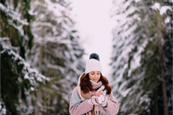 Holiday Stock Photos: Maksym Zaitsev - joyful female stands in snowy park