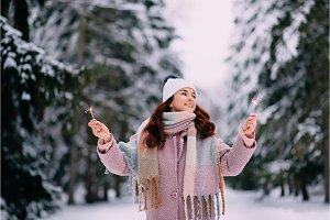 joyful woman holding burning