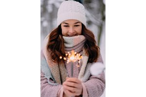 young happy woman holding burning