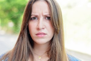 Angry young latin woman