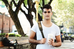 Young attractive man holding coffee