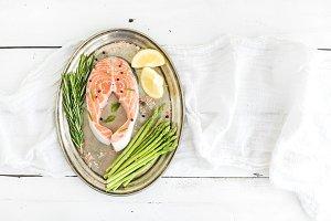 Raw salmon steak with asparagus