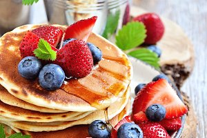 Stack of pancakes with fresh berries