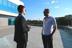 Two business men standing outdoor