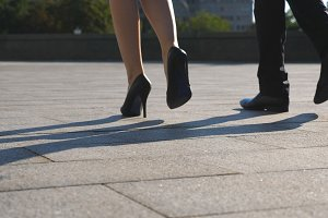 Feet of business man and woman in
