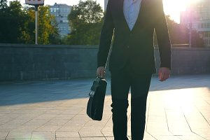 Young businessman with a briefcase