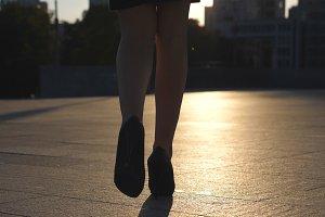 Female legs in high heels shoes