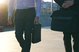 Two businessmen with briefcases