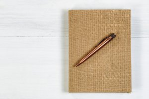 Pen and notepad on desktop