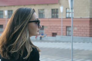 Young business woman in sunglasses