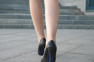 Female legs in high heels shoes