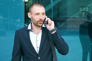 Businessman talking on phone near
