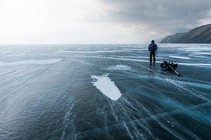 Traveller on the ice of Baikal lake
