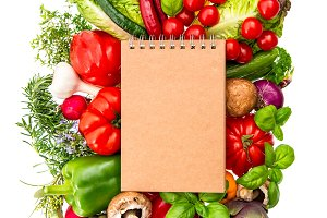 Recipe book with fresh vegetables