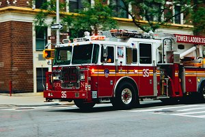 NYC Firetruck Driving on a Road