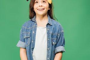 happy child in denim holding bananas