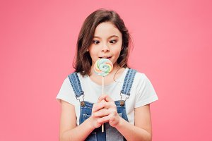 funny child holding lollipop isolate