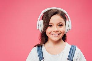 smiling kid listening music in headp