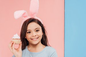 adorable child in bunny ears holding