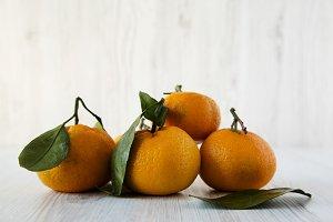 Fresh ripe unpeeled tangerines