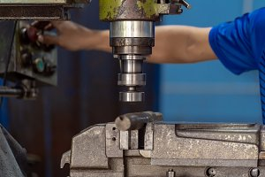 Professional machinist hand working