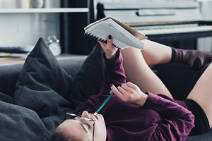 beautiful girl in glasses lying on s