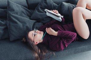attractive girl lying on sofa and ho